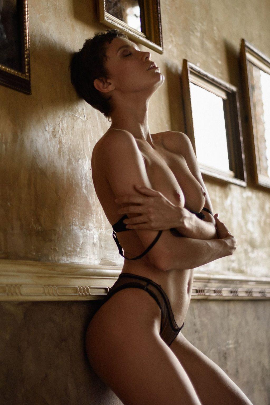 Oksana Chucha Posing by the Wall, Exposing Her Boobs